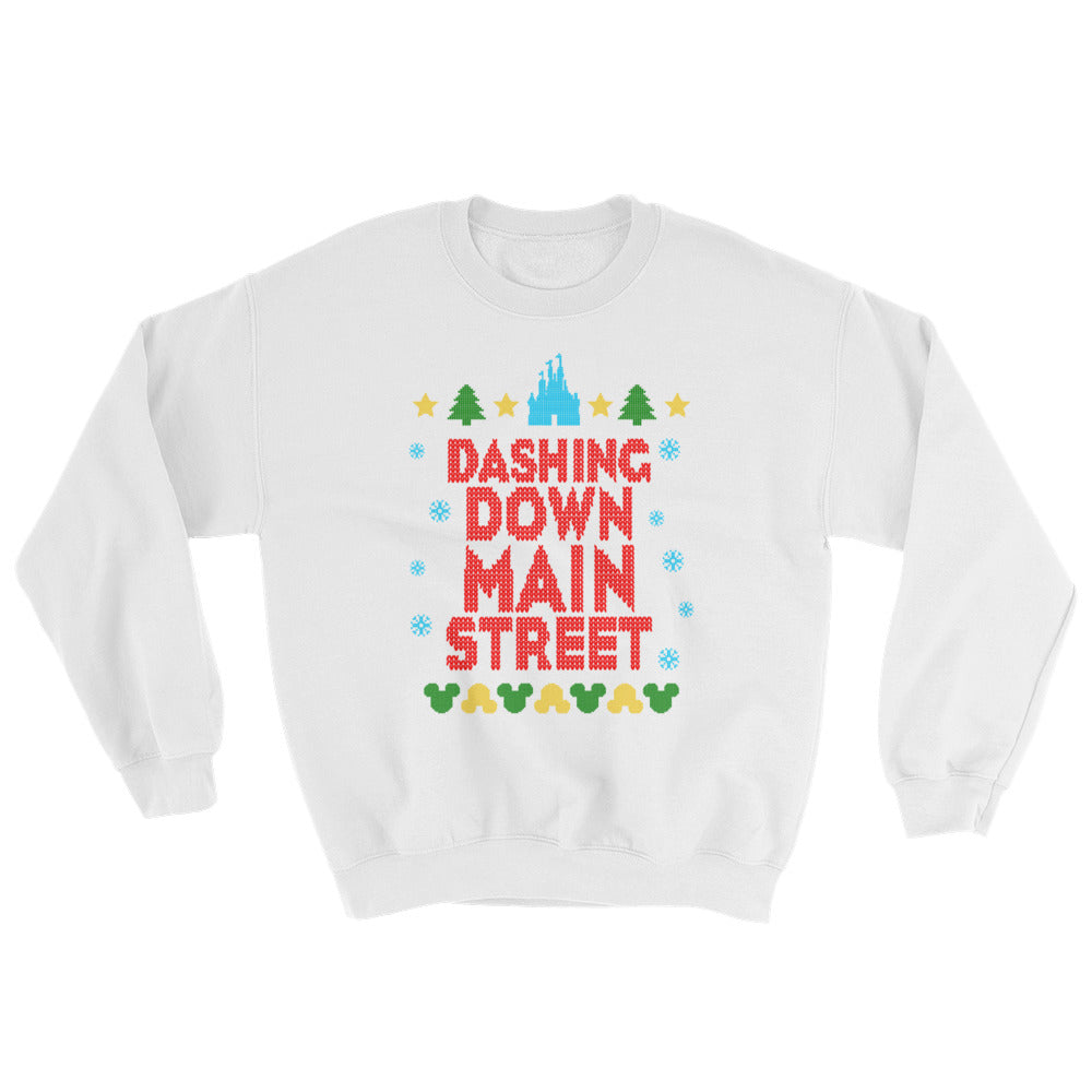 Dashing Down Main Street unisex sweatshirt. The design features a castle at the top of the design, lined up with Christmas trees and stars. The bottom of the design features reversible Mickey heads. The main part of the design is in red script and has snowflakes bordering the words. Christmas in the parks never looked so comfy!