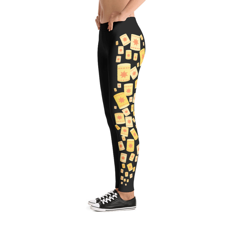 These leggings convey the perfect abundance of floating lanterns up and down the side of both of the pant legs. These Tangled themed leggings are the perfect addition to any lover of best days ever and Rapunzel herself! This particular style features the lanterns on a black background in a full-leg pant style.