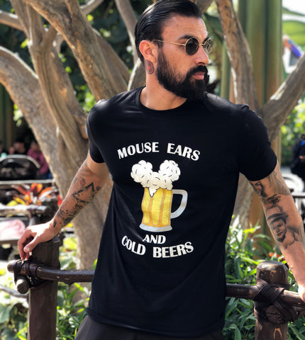 Mouse Ears and Cold Beers is a trademarked Brand By You design and it is breaking the internet! So many of our customers rave that their boyfriends or husbands were complimented on their recent trip to a Disney park while wearing this shirt and have directed them to us! Here we see one of our customers in the shirt enjoying a park day. Our most popular tee color is black and can you see why? Get our most popular shirt now!