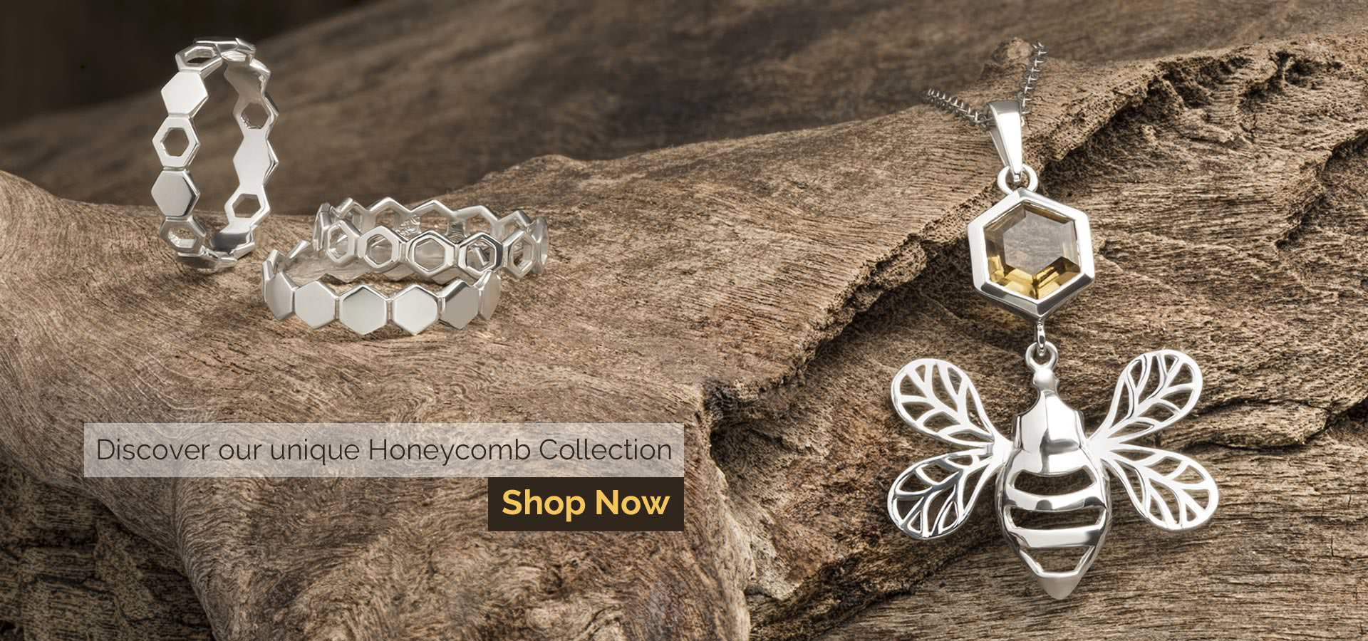 Honeycomb jewellery on wooden background