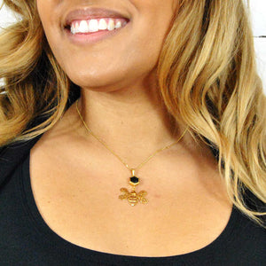 Gold Bee Pendant with Faceted Black Onyx on Model