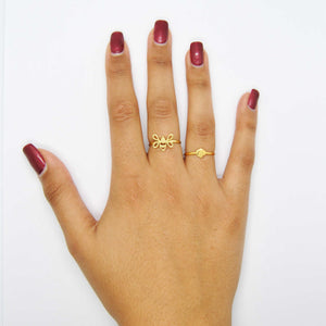 Gold Tiny Bee Ring and Tiny Hexagon Ring on Hand