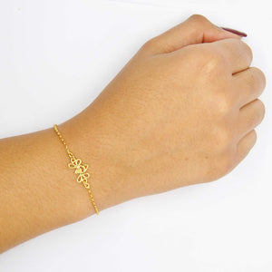 Gold Tiny Bee Bracelet on Wrist