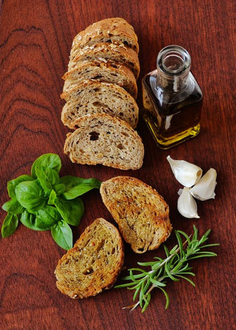 italian bread and olive oil table spread