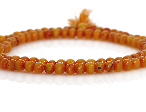 Amber Buddhist Mala Beads Close Up