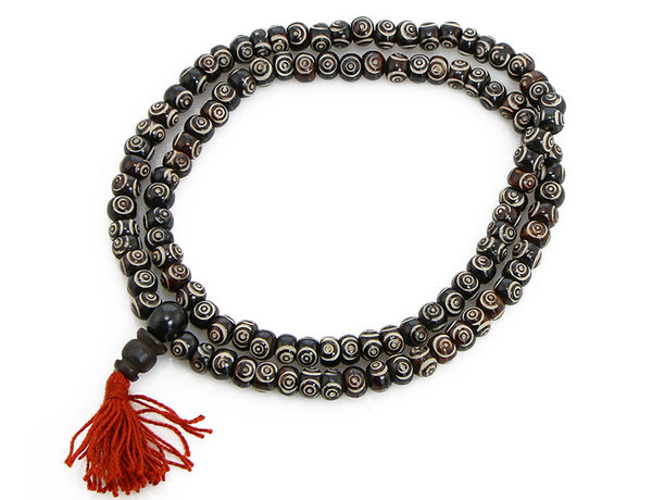 Buddhist Mala Beads with Carved Chakra Symbols Top View