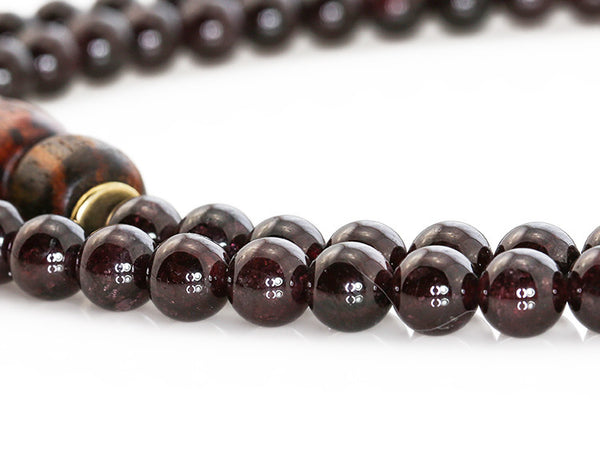 Buddhist Mala Beads with Garnet and Rengas Tiger Wood Close Up