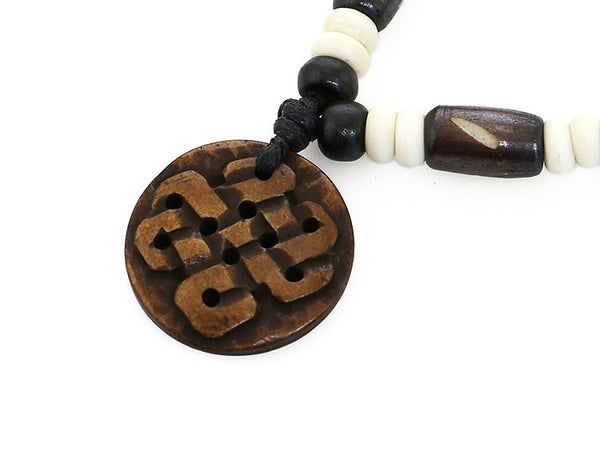 Tibetan Buddhist Necklace with Carved Endless Knot Pendant Close Up