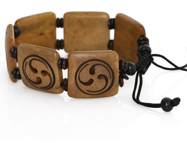 Tibetan Buddhist Bracelet Carved Wheel of Joy Symbol Close Up