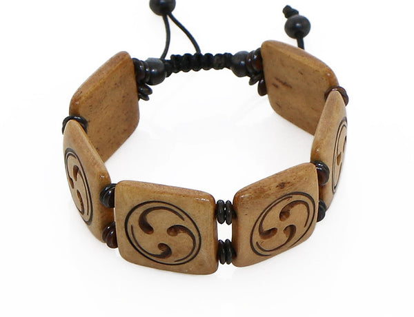 Tibetan Buddhist Bracelet Carved Wheel of Joy Symbol Top View