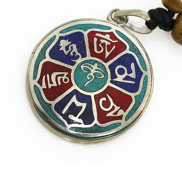 Tibetan Buddhist Pendant with Silver and Turquoise Lotus Buddha Eyes Design