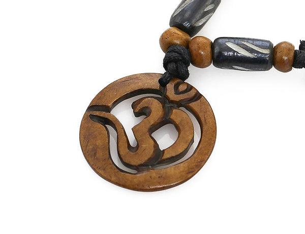 Yoga Necklace Cut Out Brown Om Symbol Pendant Close Up