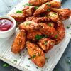Low FODMAP Baked Chicken Wings with Curry and Sesame Seeds Recipe