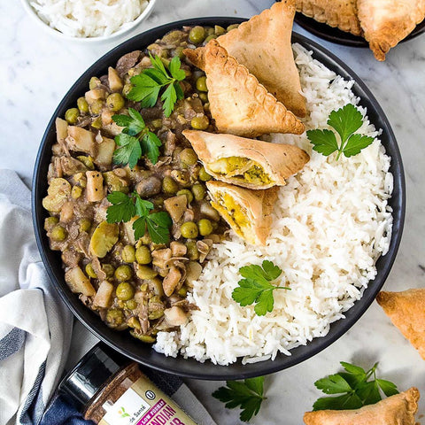 Low FODMAP Potato and Pea Curry with Vegetable Samosas and Steamed Rice