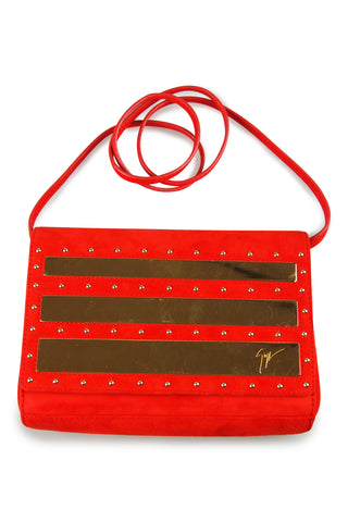Red suede studded clutch