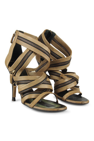 Tan strappy and zippy sandals