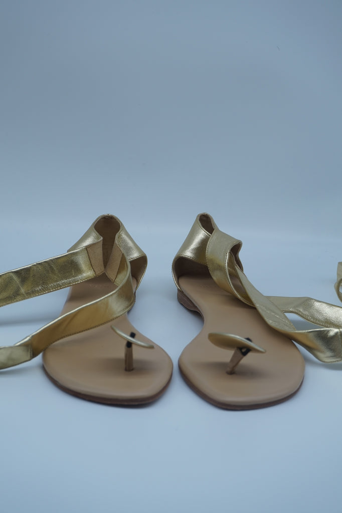 Hermes Tied-Up Flat Sandals in Gold