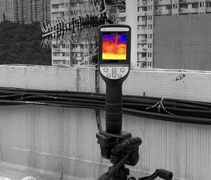 PerfectPrime thermal camera on a stand facing buildings
