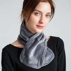 Model with grey scarf around neck