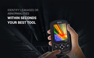 Hand holding handheld thermal camera in industrial location