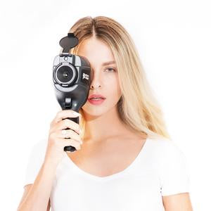Model holding infrared thermal imaging camera to her right eye