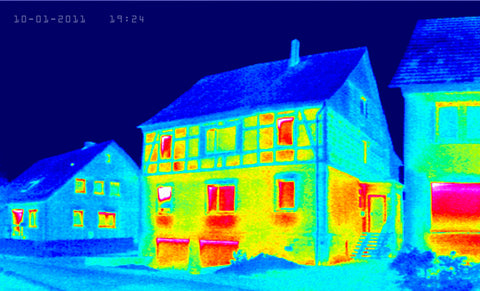 Thermal images of three houses showing heat inside the windows of the houses