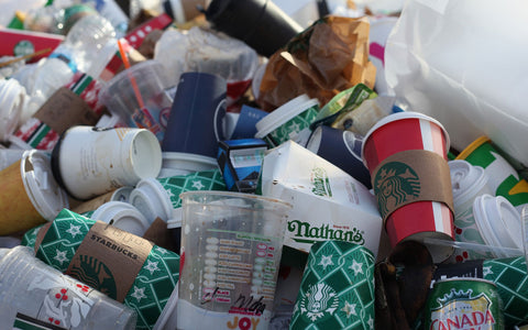 Mound of garbage with majority being starbuck's cups