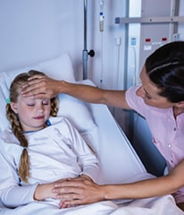A child is sick and a nurse is taking care of her