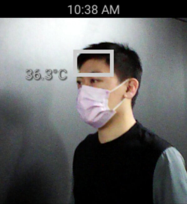 Right side view of a man's forehead temperature detection
