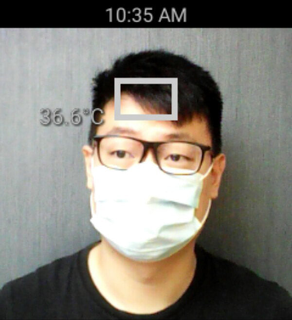 Front view of a man's forehead temperature detection