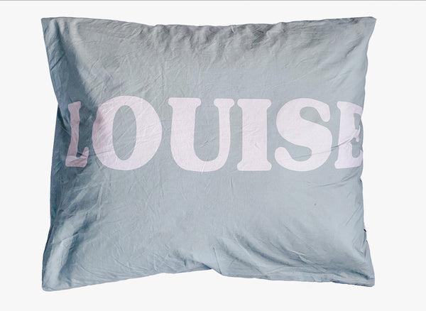 Personalized cushion with your child's name.