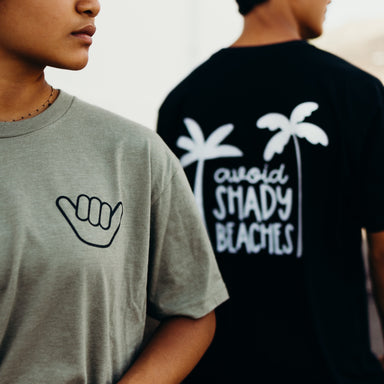 AVOID SHADY BEACHES UNISEX TEE