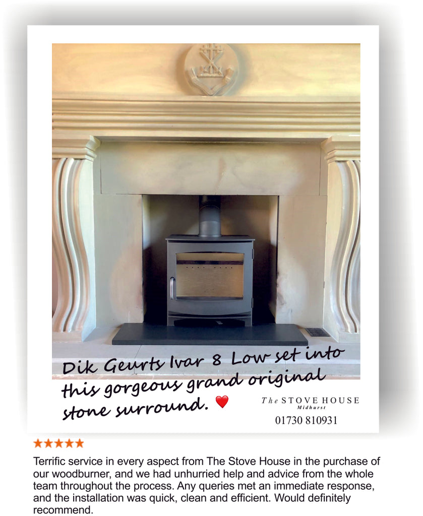 A Dik Geurts Ivar 8 Low woodburner installation into a stone fireplace surround