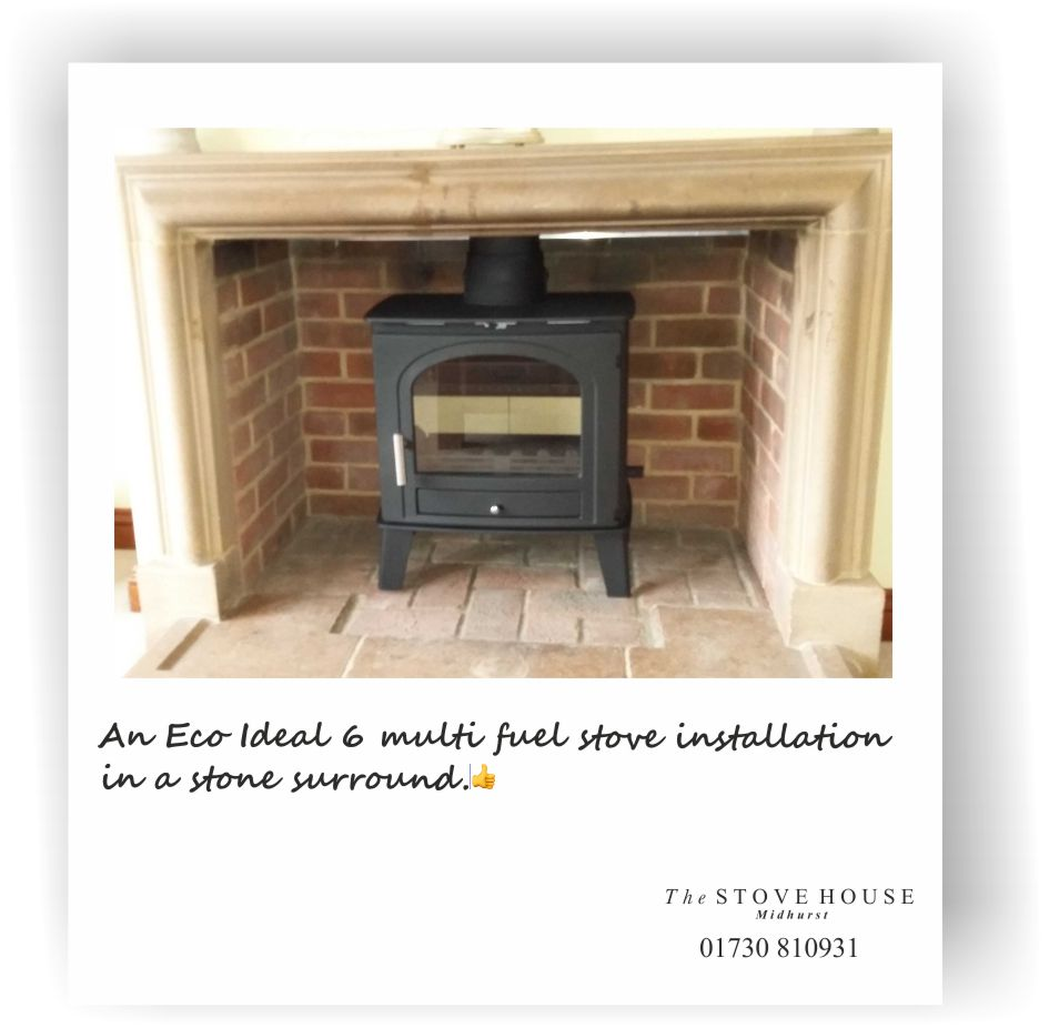An Eco Ideal 6 in a stone surround, supplied & Installed by The Stove House