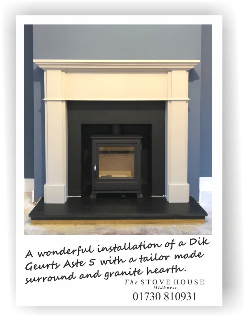 Dik Geurts Aste 5 Low Woodburning in a Bespoke Winterfold Timber Mantle with Cambridge Clay painted finish and honed black granite