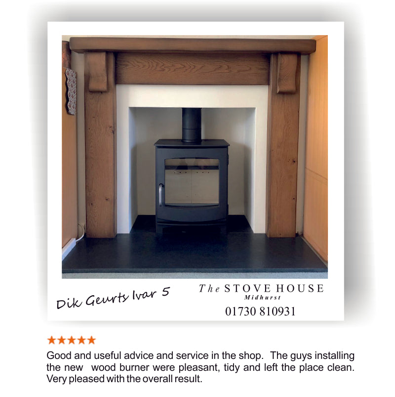 Dik Geurts Ivar 5 wood burner installation with solid oak fireplace surround and slate hearth