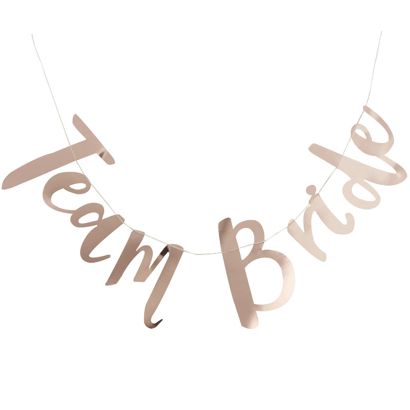 ROSE GOLD TEAM BRIDE BUNTING from Pop Cloud Bristol who offer a huge range of partyware, wedding and event hire decorations