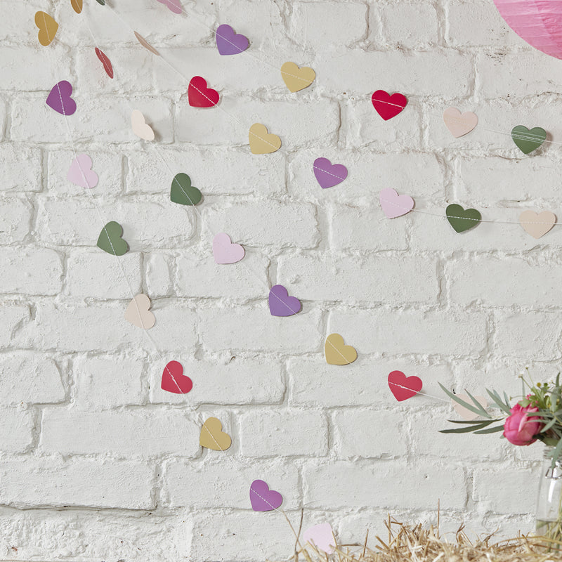 COLOURFUL MINI HEART BUNTING from Flingers Party World Bristol Harbourside who offer a huge range of fancy dress costumes and partyware items