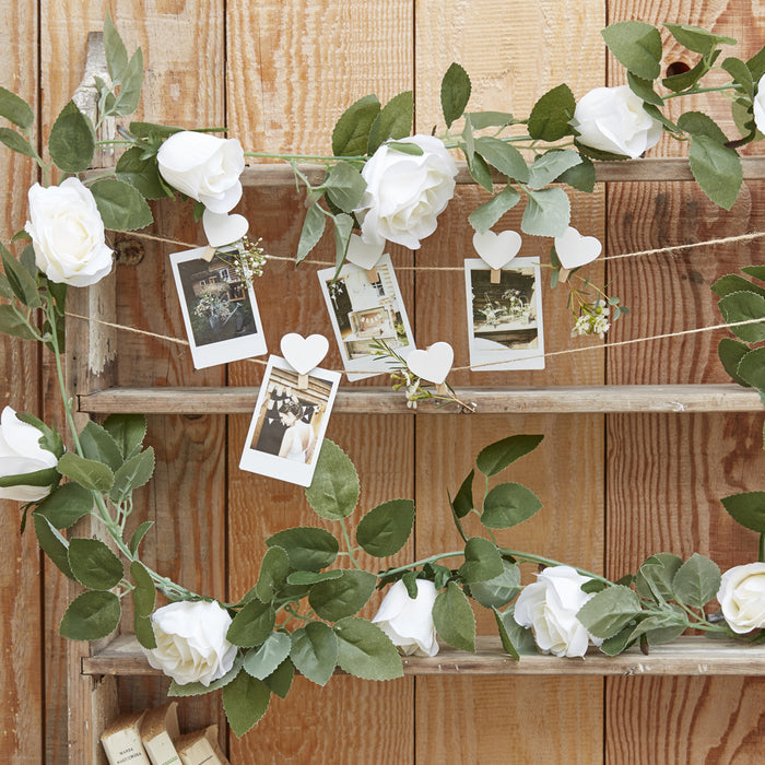 DECORATIVE WHITE ROSE FLOWER ARTIFICIAL FOLIAGE GARLAND from Flingers Party World Bristol Harbourside who offer a huge range of fancy dress costumes and partyware items