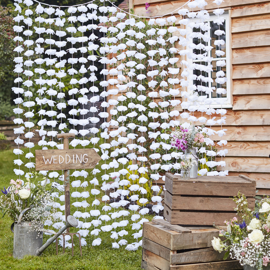 WHITE PETAL FLOWER BACKDROP from Flingers Party World Bristol Harbourside who offer a huge range of fancy dress costumes and partyware items