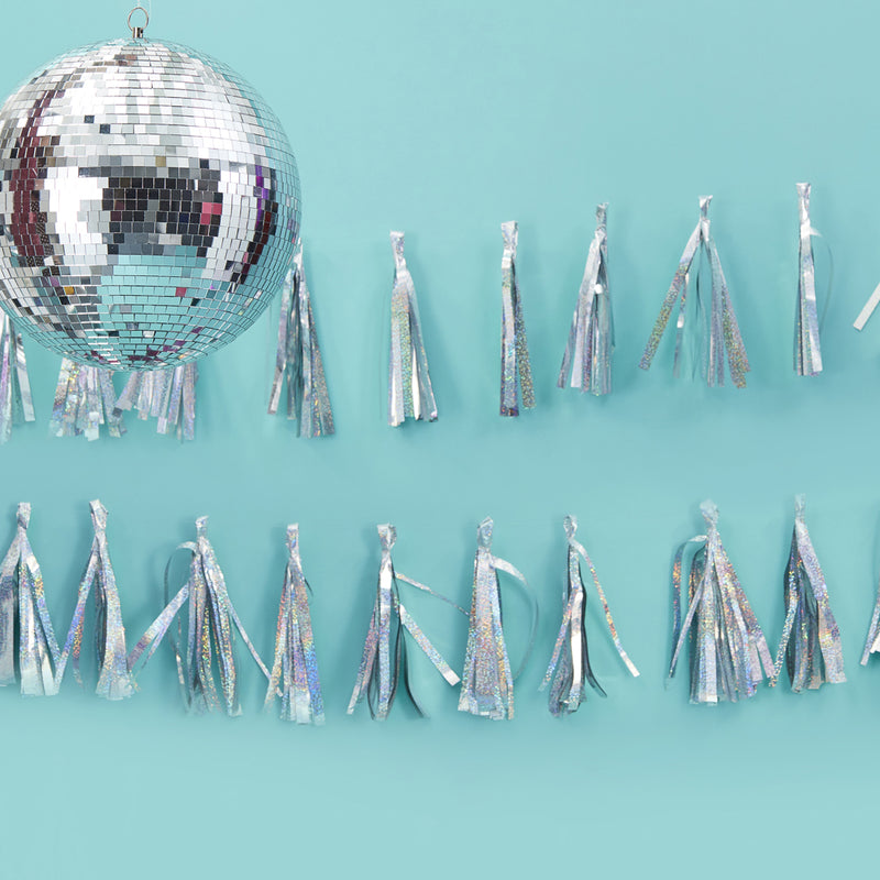IRIDESCENT SPARKLE TASSEL GARLAND from Flingers Party World Bristol Harbourside who offer a huge range of fancy dress costumes and partyware items