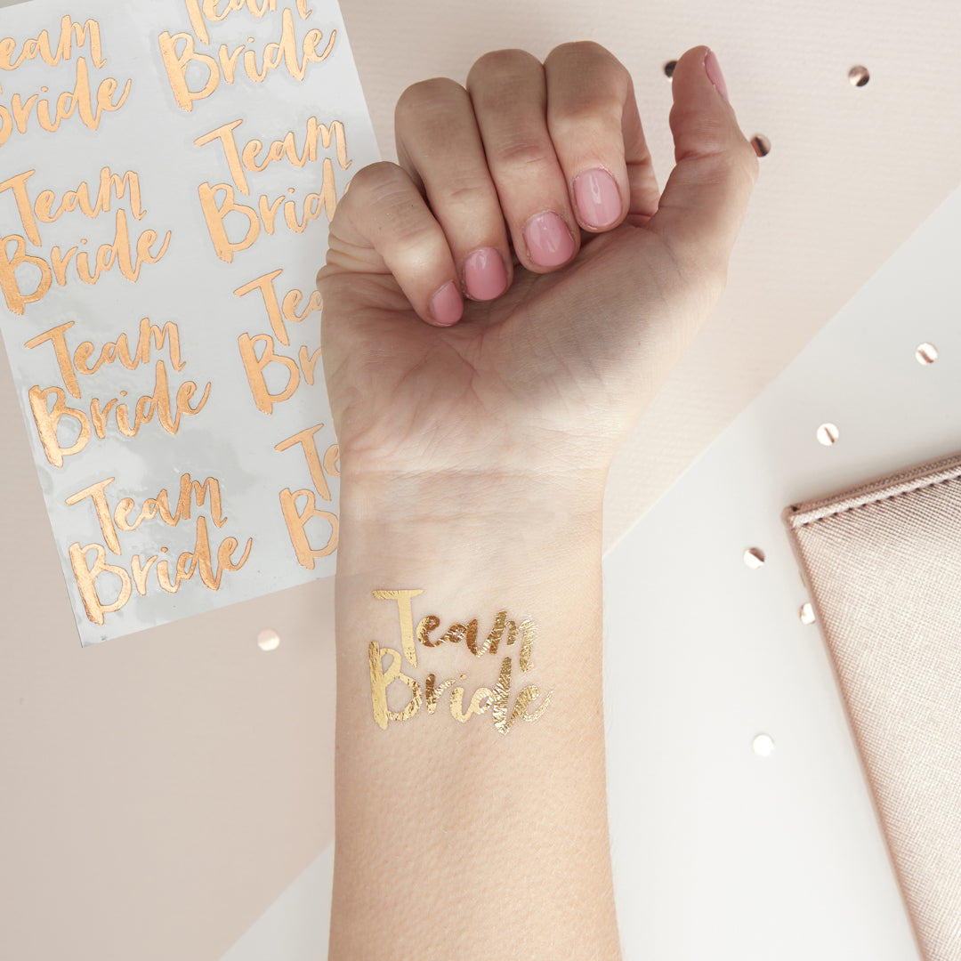 ROSE GOLD TEAM BRIDE HEN PARTY TATTOOS from Flingers Party World Bristol Harbourside who offer a huge range of fancy dress costumes and partyware items