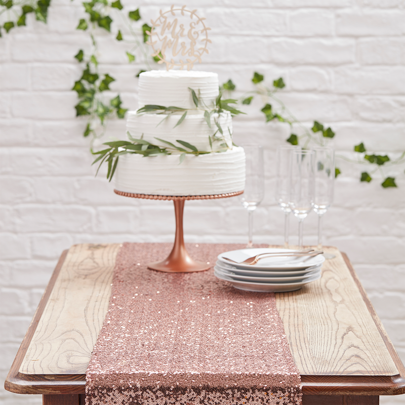 ROSE GOLD SEQUIN TABLE RUNNER from Flingers Party World Bristol Harbourside who offer a huge range of fancy dress costumes and partyware items