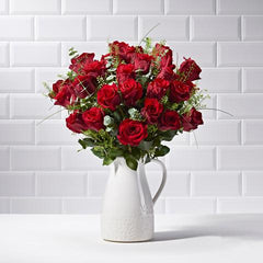 Wide shot of 24 Red Roses in a vase - luxury bouquet of flowers - red rose