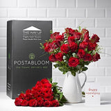 Wide shot of 50 Red Roses in a vase - luxury bouquet of flowers - red rose
