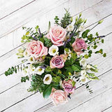Above & Beyond hand tied bouquet of flowers