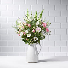 Wide shot of Above and Beyond in a vase - luxury bouquet of flowers - lavender, pink roses