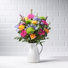 Wide shot of Carnival - luxury bouquet of flowers - orange roses, pink gerberas