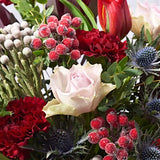 Close up of Festive Dream - luxury Christmas bouquet of flowers - pink roses and red tulips