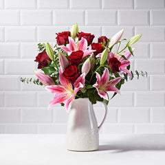 Wide shot of Paradise in a vase - luxury bouquet of flowers - red roses and pink lilies